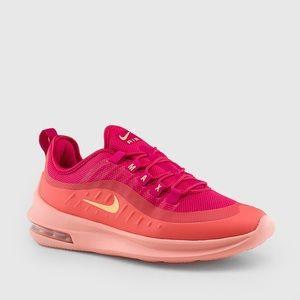 Woman's pink orange Nike air tennis shoes